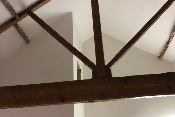 Kipling House Barn has vaulted ceilings and original beams
