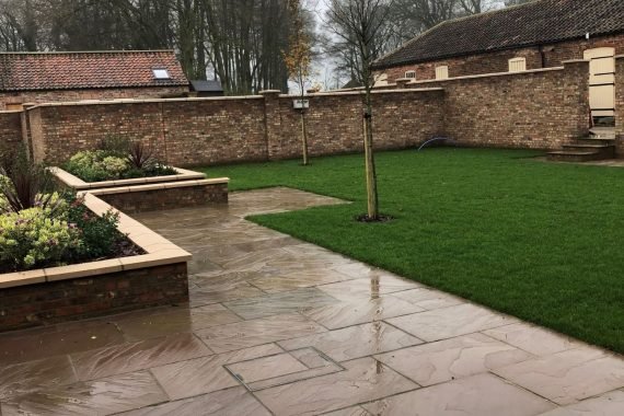 The landscaped courtyard area is perfect for alfresco dining and BBQs